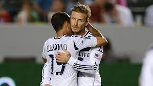 L.A. Galaxy's Juninho and David Beckham share a $3,935,000 hug. Worth every cent.