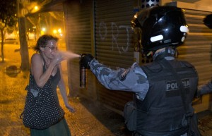 How to deal with a polka dot bag in Rio? Pepper spray. Credit: AP Photp via TheAtlantic.Com
