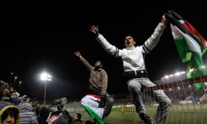 Palestinian fans (don't yet) celebrate hosting the 2019 Asian Cup.