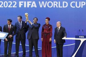 Qatar's bidding team and FIFA president Sepp Blatter are all smiles after the announcement that Qatar is going to be host nation for the FIFA World Cup 2022.