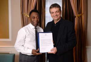 Pele and Jerome Champagne. It's probable  a similar photo exists in Sepp Blatter's scrapbook.