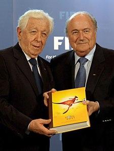 FFA chairman Frank Lowy hands FIFA President Sepp Blatter a book
