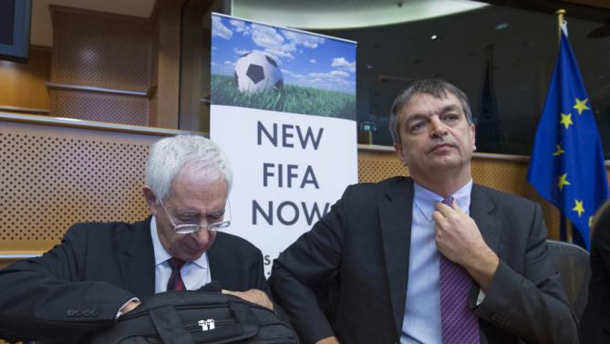 "David Triesman (left) looks in his bag for the future of football. Hopeful FIFA presidential candidate Jerome Champagne believes he is it at the New FIFA Now summit  in Brussels. Pic ""on loan"" from REUTERS/Yves Herman https://de.eurosport.yahoo.com/fotos/former-chairman-england-fa-triesman-fifa-presidential-candidate-photo-122705042.html"
