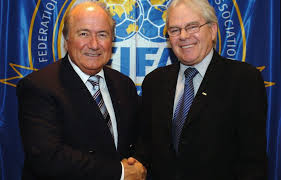 Sepp Blatter and a cheerleader (update: actually SBS TV broadcaster Les Murray).