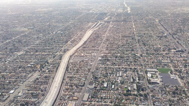 1200px-South-Los-Angeles-110-and-105-freeways-Aerial-view-from-north-August-2014